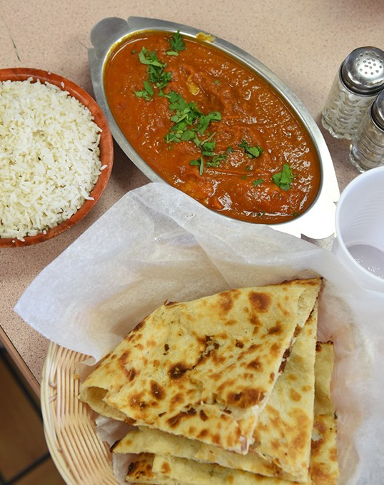 Fish curry with naan and rice. - GAZETTE/FILE