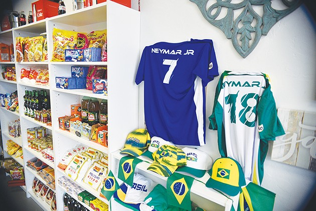Brazilian memorabilia sits next to a market of dry goods and candy at Moore de Brasil. - JACOB THREADGILL