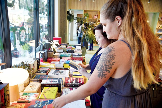 Asheley Middleton and Jenna Swanson browse for reading material at Commonplace Books. - JACOB THREADGILL