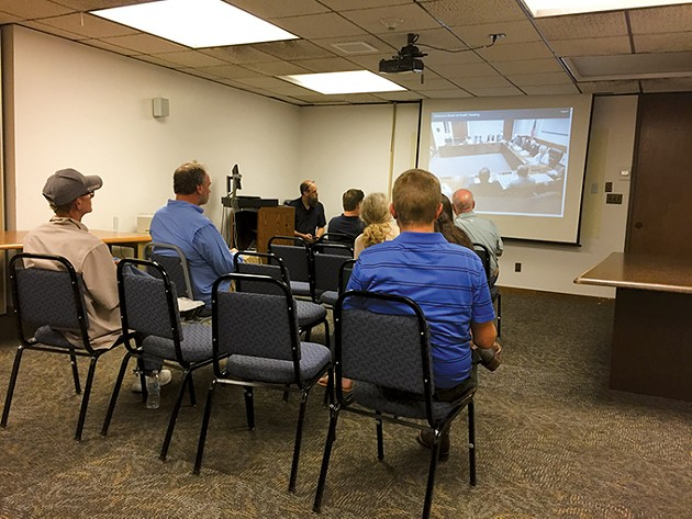 Members of the public watch a live broadcast of the special State Board of Health meeting Aug. 1 - BEN LUSCHEN
