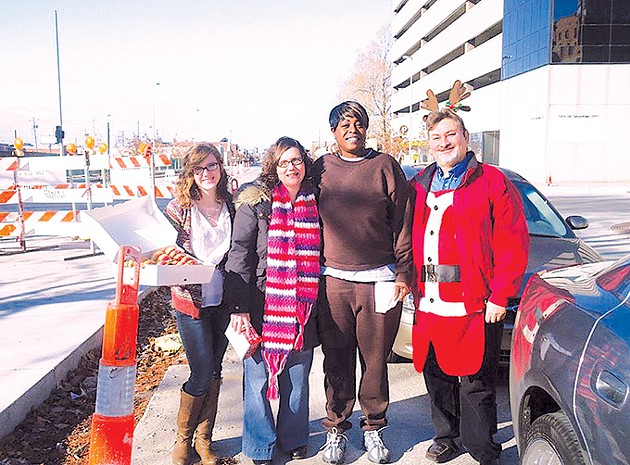Founder Rick Swyden has had help from outreach coordinator Beth Solis second from left, her daughter Sarah Nawotka left and former Hotdogs for the Homeless hotdog recipient Sherry Hassell since at least 2011. - HOTDOGS FOR THE HOMELESS / PROVIDED