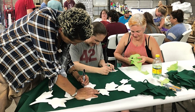 from left Factory Obscura volunteers Kaalen O'Bannon, Alena Snyder and Kaylyn Cavett work together to create felt art leaves. - NAZARENE HARRIS