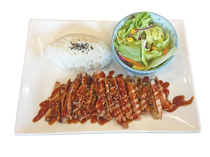 Chicken teriyaki thigh meat with rice and salad, a standard teriyaki plate order - JACOB THREADGILL