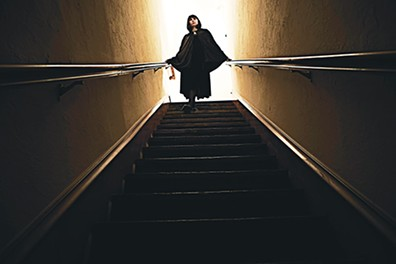 Mary Buss descends a staircase in Strike, Dear Mistress, and Cure His Heart, screening 8 p.m. Oct. 18 at Rodeo Cinema. - PROVIDED