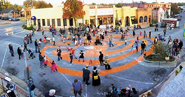 Magic Lantern ends with a parade through a pumpkin-shaped labyrinth painted in the street. - PAIGE POWELL / PROVIDED