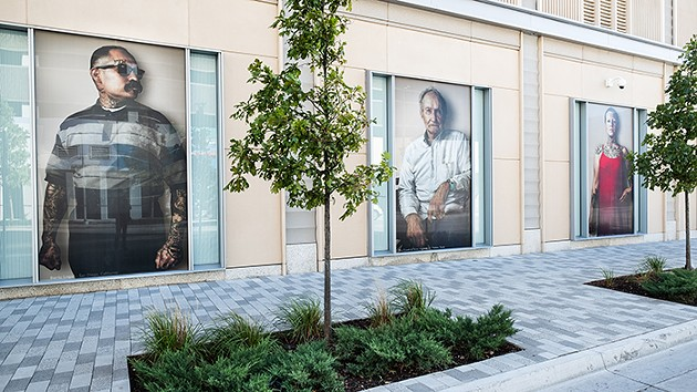 Portraits from photographer John Raymond Mireles' Neighbors Project are on display outside the BOK Park Plaza building at the intersection of N. Walker and W. Sheridan avenues until April 15. - JOHN RAYMOND MIRELES / PROVIDED