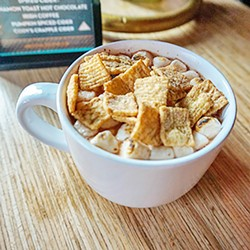 The Cinnamon Toast Crunch Hot Chocolate at - The Other Room, 3009 Paseo St., gets - blowtorched and dusted with the popular cereal. - MALORY CRAFT