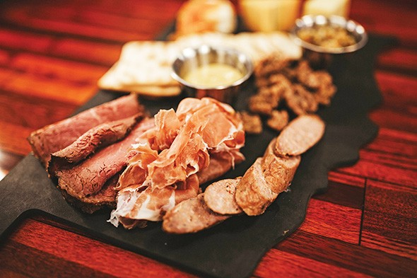 The meat-and-cheese plate features Oklahoma sausage, mustard and in-house brined and smoked pastrami. - ALEXA ACE