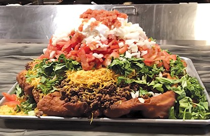 The 13.5-pound Indian taco at The Miller Grill is the largest food challenge in the Oklahoma City area, if not the country. - ROBERT MCKINNEY / PROVIDED
