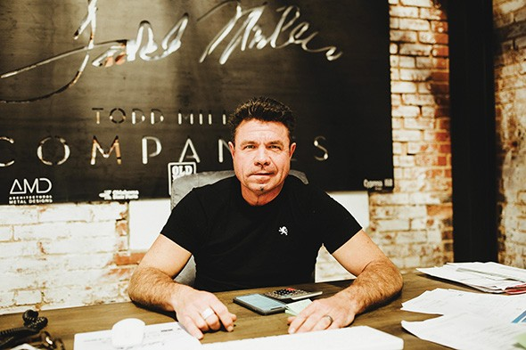 Todd Miller's passions for custom ironworks and vintage wood are reflected in his furniture company, Grain & Grange. - ALEXA ACE