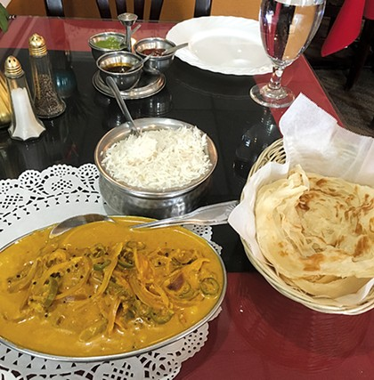 Malabar fish curry with kerala paratha, a layered flatbread from southern India - JACOB THREADGILL