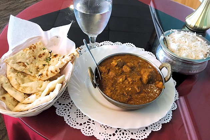 Chicken varutharachathu with basmati rice and garlic naan. - JACOB THREADGILL