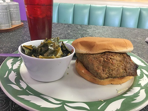 A meatloaf sandwich with a side of collard greens - JACOB THREADGILL
