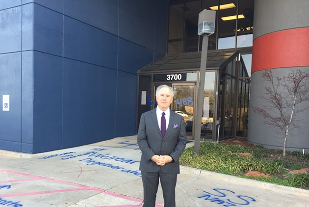 Former Gov. David Walters stands in front of the Oklahoma Democratic Party headquarters, which was hit with racist graffiti on Thursday. - GEORGE LANG