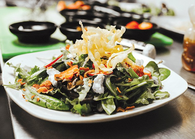 The Guyutes salad tops mixed greens with strawberries, goat cheese, chopped bacon and fried wonton strips along with its infused honey dressing. - ALEXA ACE
