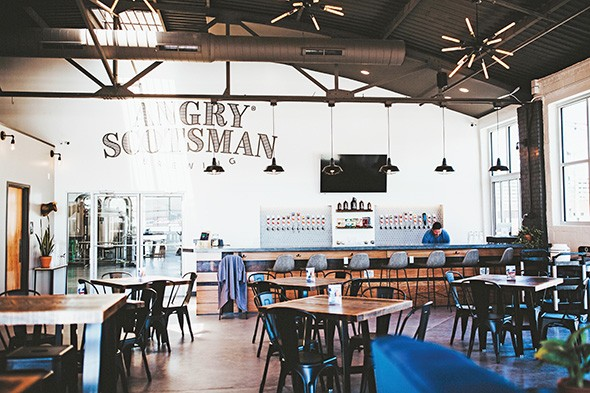 Angry Scotsman's new taproom boasts an airy and inviting space and 24 beer taps. - ALEXA ACE