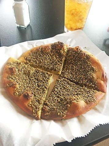 Za'atar pie served on manakeesh flatbread - JACOB THREADGILL