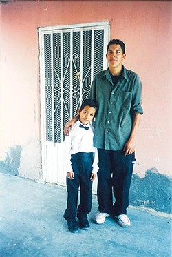 Miguel poses for a picture with his brother after graduating kindergarten. - PROVIDED