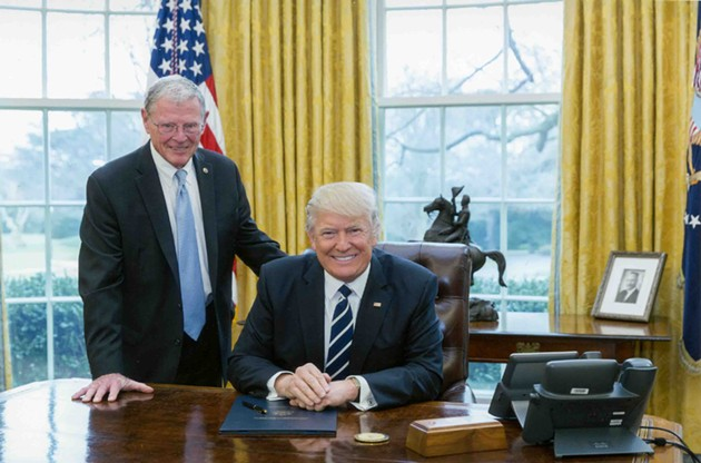 U.S. Sen. Jim Inhofe, R-Oklahoma, poses with President Donald Trump. Inhofe claims that Consumer Fraud Protection Bureau regulations are causing banking fees to rise. - PROVIDED