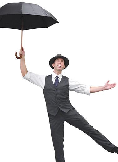 Jeremy Benton plays Don Lockwood in Lyric Theatre's production of Singin' in the Rain. - LYRIC THEATRE / PROVIDED