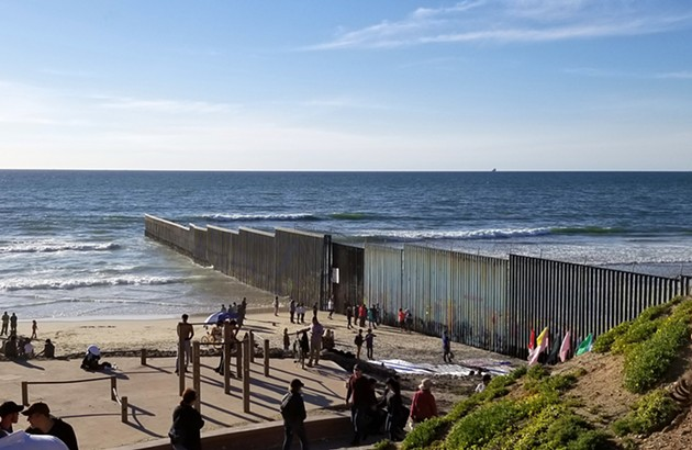 Migrants gather at the border at Playa de Tijuana, Baja California, Mexico. - PHOTO BIGSTOCK.COM