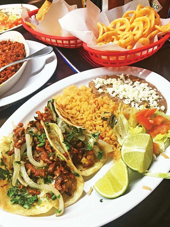 Tacos arabes filled with al pastor and cheese - JACOB THREADGILL