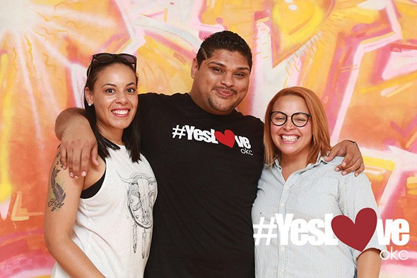Albert Rios, YesLove OKC executive director, poses with two attendees at a previous #YesLove Photoshoot. - PROVIDED