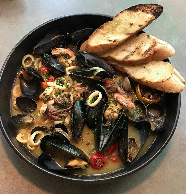 Traditional French bouillabaisse gets a touch of cream to be served Moroccan-style with mussels, clams, shrimp and squid.