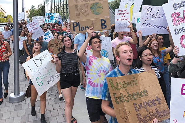 Hundreds of Oklahomans took to downtown last week as part of the global youth climate strike to call attention to the climate crisis. - PROVIDED