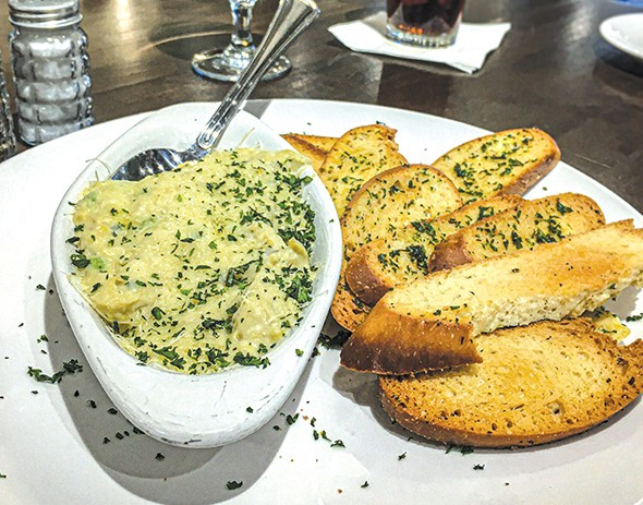 Artichoke dip appetizer at Bellini's - JACOB THREADGILL