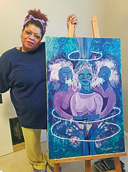 "Tiffani Nicole Sanders with her painting ""Safe Space"" - OKLAHOMA CALL FOR REPRODUCTIVE JUSTICE / PROVIDED"