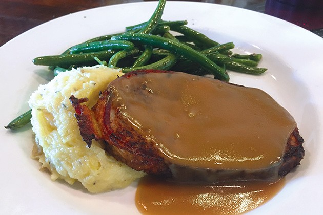 Bacon-wrapped bison meatloaf with green beans and mashed potatoes - JACOB THREADGILL