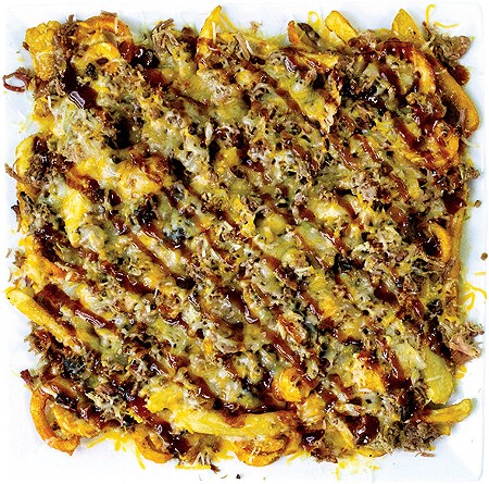 Holy Smokes — more than 2 pounds of a mixture of fry preparations topped with pulled pork, sauce and cheese - ALEXA ACE