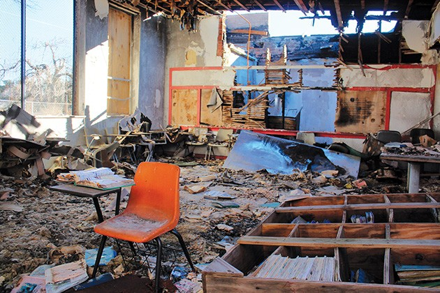 Before historic Dunjee School in Spencer burned down in 2012, it still held furniture and schoolbooks as well as personal items from its caretaker and former student Theotis Payne, who had reopened the building as a school for at-risk youth in 1998. - MICHAEL SCHWARZ / ABANDONED OKLAHOMA / PROVIDED