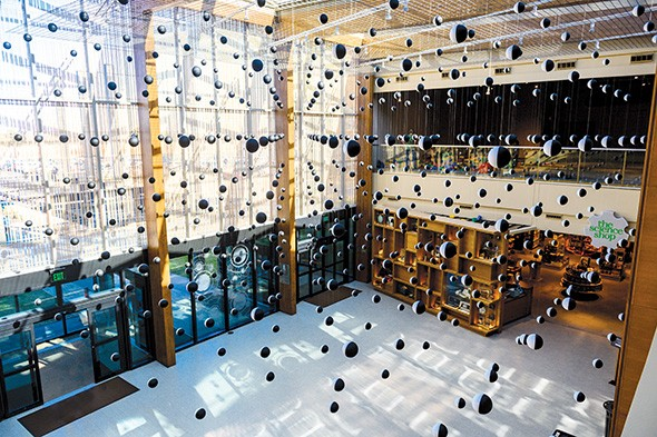 """""""Atom Compass Array"""" comprising hundreds of magnetic spheres, hangs in the lobby at Science Museum Oklahoma as part of Tom Shannon: Universe in the Mind 