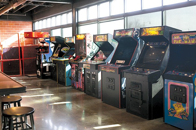 Gamers Arcade Bar, which features various arcade games, a mural by a local artist and a full-service bar, is connected to the comedy club. - ALEXA ACE