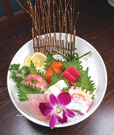 Sushi entrees at Ichiban are garnished with flowers and leaves. - PHILLIP DANNER