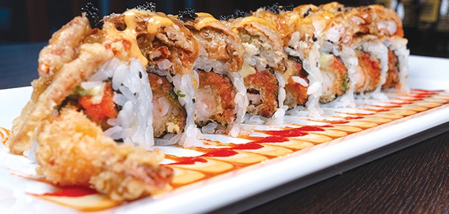 The Ichiban Roll is shrimp tempura, tuna and avocado topped with soft-shell crab. - PHILLIP DANNER