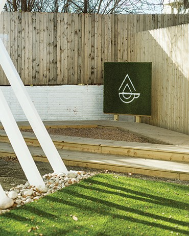 Play Cafe has a back patio with a rock pit instead of sand. - EMILY FLETCHER / PROVIDED