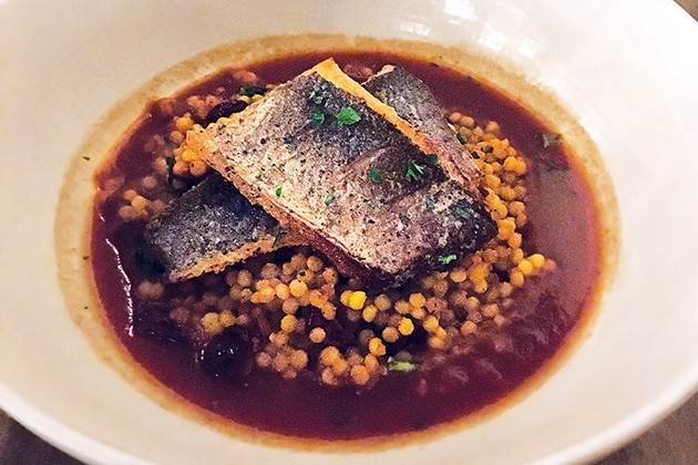 Crispy branzino served over saffron couscous and lobster broth - JACOB THREADGILL