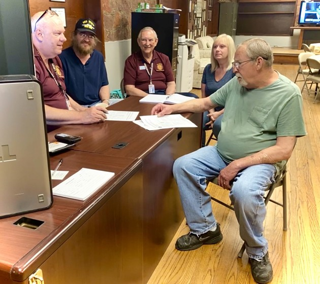 Members of the Norman American Legion Post 88, assisting one of their fellow vets. From left are: Post 88 Senior Veterans Service Officer Carl Ellison, and VSOs Coy Hensley, Harley McPeek and Tammie Richard. - PROVIDED BY NORMAN AMERICAN LEGION POST #88