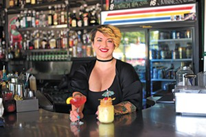 Meghanne Hensley, bartender, at the Pump Bar, Friday, Aug. 11, 2017.  (Garett Fisbeck)