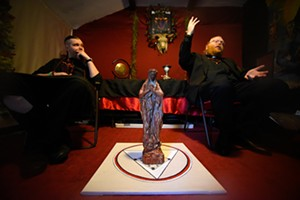 Adam Daniels and Jeremy Melvin talk about an upcoming black mass at the Church of Ahriman Satanists in Oklahoma City, Thursday, May 19, 2016.  (Garett Fisbeck)