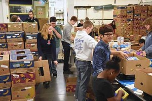 Volunteers from Life Christain Academy and South Moore Hight School work with donations in the Volunteer Center at Regional Food Bank of Oklahoma.  mh