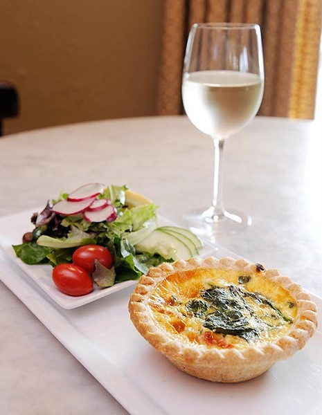 Quiche florentine, side salad, and white wine at La Baguette Bistro in Oklahoma City, Wednesday, Jan. 28, 2015. - GARETT FISBECK