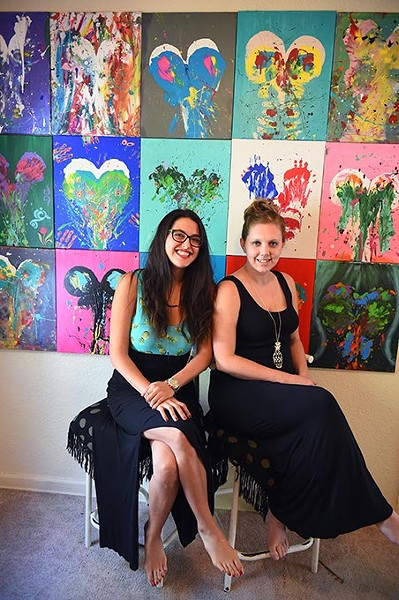 Left to right, Lindsey Michelle Webb and Kelly Brinkmeyer with breast-print paintings, 9-22-15. - MARK HANCOCK