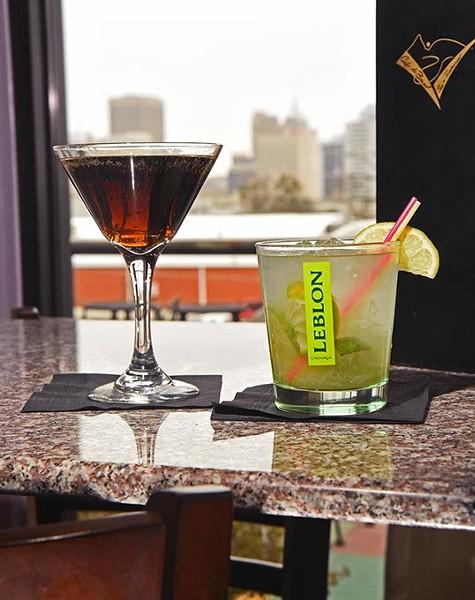 Specialty coctails including the popular Caipirinha, at right, with a view at the Bossa Nova Caipirinha Lounge in MidTown Oklahoma City, 1-22-16. - MARK HANCOCK