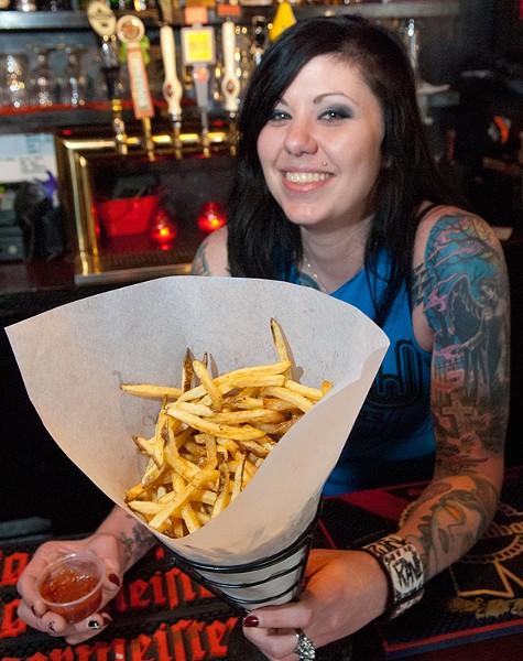 Staff member Jolie Foster with Drunken Fry's belgian fries and sauce. (Mark Hancock)
