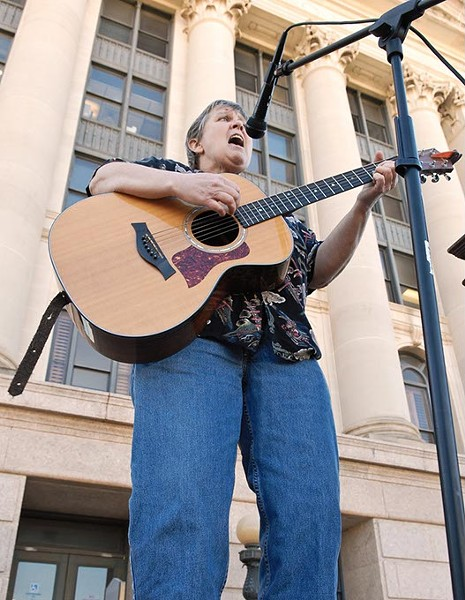 """Mary Catherine Reynolds belts out a rendition of """"This Land is Your Land"""" to open the rally for the expansion of Medicaid held on the north steps of the Oklahoma State Capitol, 2-5-13.  mh"""