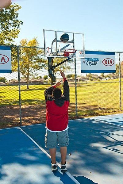 A boy plays basketball on the newly referbished court at Schilling Park off SE 25th Street.  mh